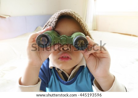 Happy kid playing with toy sailing boat ,little asian boy enjoy travel ,Travel and recreation concept - stock photo