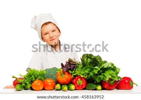Happy kid preparing healthy vegetables meal - stock photo