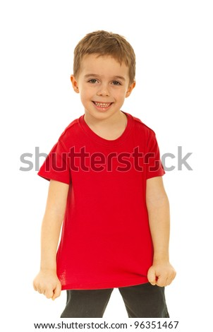 Happy kid showing his blank red t-shirt isolated on white background