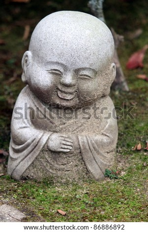 Happy kid statue, Japan - stock photo