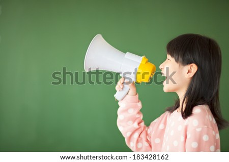 happy kid using a megaphone to shout - stock photo