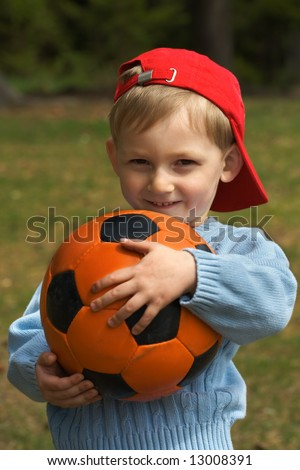 Happy kid with a ball - stock photo