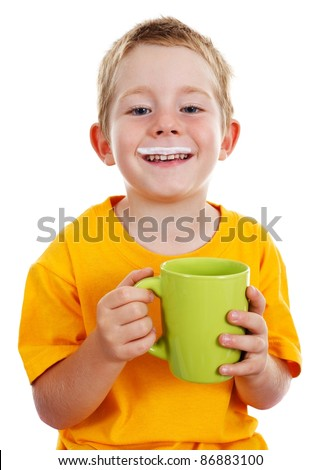 Happy kid with milk mustache holding big green cup in-front of him