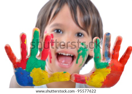 Happy kid with paints on hands - stock photo