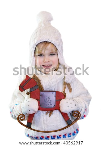 Happy kid with presents - rocking horse. Isolated on a white.