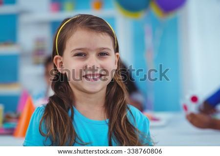 Happy kids celebrating a birthday together - stock photo