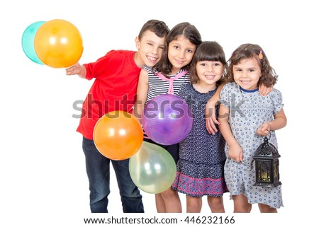 Happy kids celebrating Eid El Fitr - Muslim Children playing with lantern and baloons in the feast