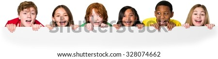 Happy kids children peeking above an invisible edge - stock photo