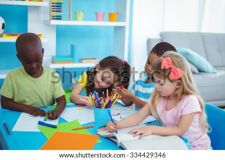 Happy kids enjoying arts and crafts together in the bedroom