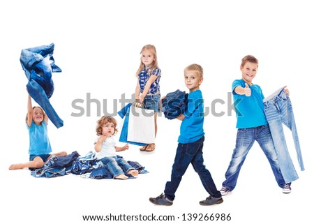Happy kids group with jeans clothing - stock photo