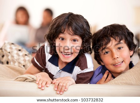 Happy kids having fun at home and smiling - stock photo