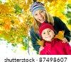 Happy Kids having fun in Autumn Park - stock photo