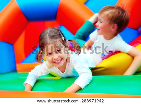 happy kids having fun on playground in kindergarten - stock photo