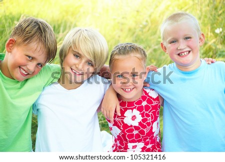 happy kids outdoor looking at camera in summertime