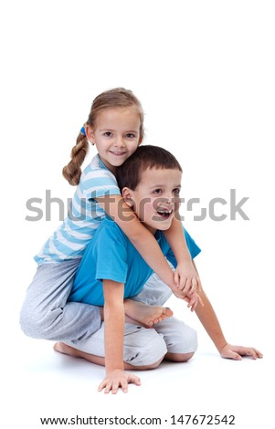Happy kids playing and wrestling on the floor - isolated - stock photo
