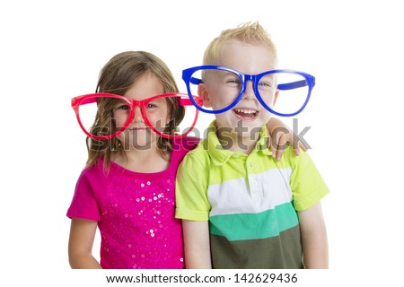 Happy kids playing together with costumes - stock photo