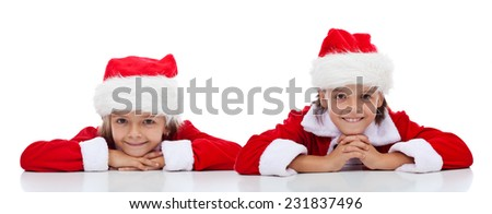 Happy kids smiling in Santa Claus outfit - isolated - stock photo