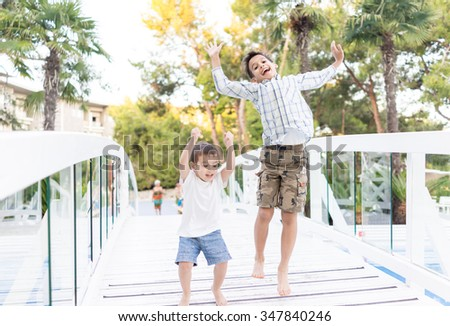 Happy kids spending holiday vacation in beautiful resort - stock photo