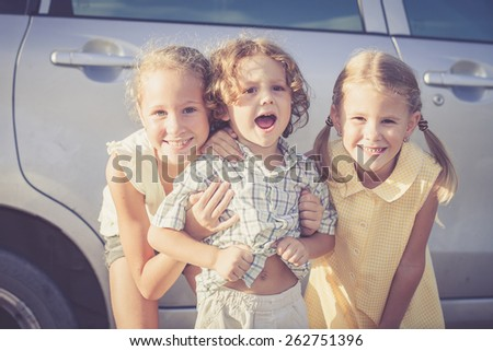 Happy kids standing on the road at the day time. Concept Brother And Sister Together Forever - stock photo