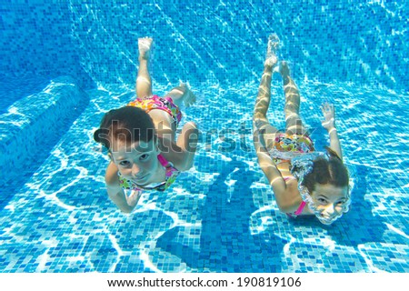 Happy kids swim underwater in pool and having fun, children on summer  vacation, sport concept  - stock photo