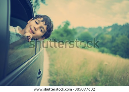 Happy kids travel by the car - stock photo