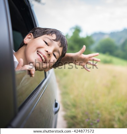 Happy kids travel by the car