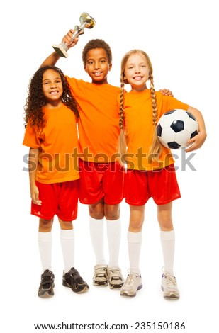 Happy kids winners of soccer game with prize cup - stock photo