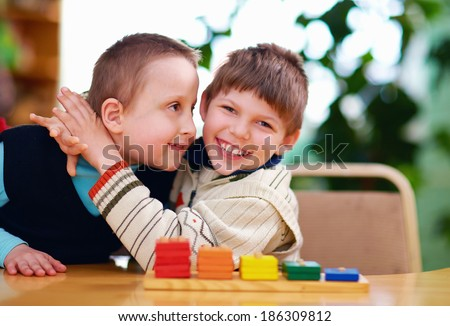 happy kids with disabilities in preschool - stock photo