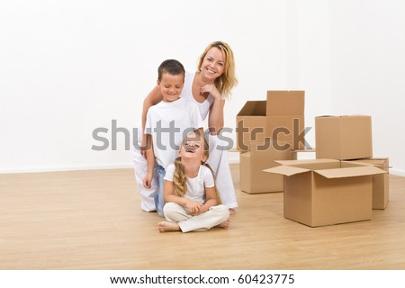 Happy klds and woman in their new big home - stock photo