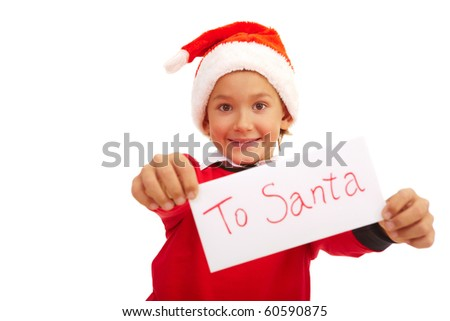 Happy lad holding letter with note ?To Santa? in isolation - stock photo