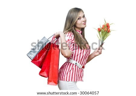 Happy lady after shopping with tulips, isolated on white - stock photo