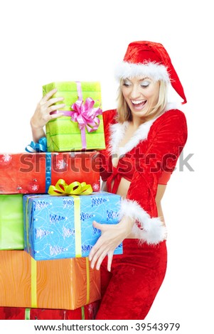 Happy lady in Santa Claus costume holding colorful gift boxes on a white background