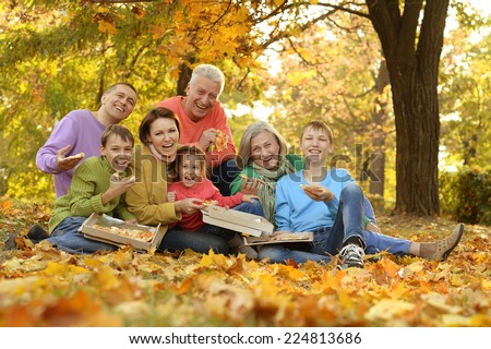 Happy large family picnic in the woods - stock photo