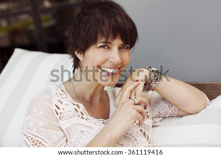Happy latin adult woman smiling - stock photo