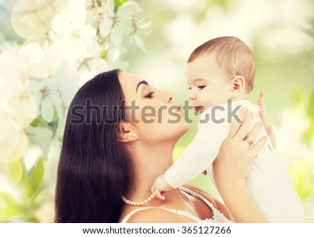 happy laughing baby playing with mother - stock photo