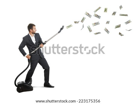 happy laughing businessman holding vacuum and catching paper money over white background - stock photo