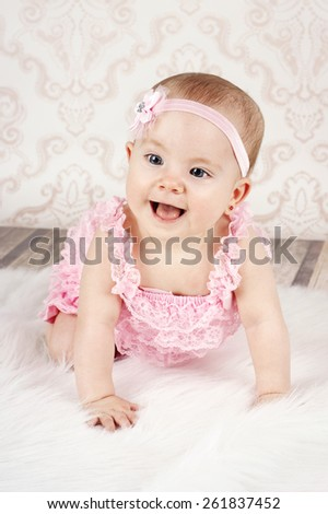 Happy laughing crawling baby girl - stock photo
