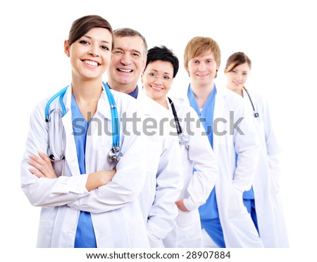 happy laughing female doctors in hospital gowns in row - stock photo