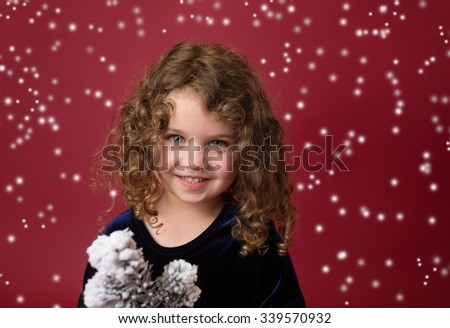 Happy, Laughing girl, Christmas or winter holiday themed setup on red background, copyspace - stock photo