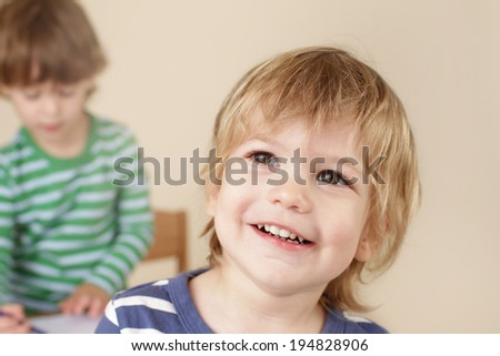 Happy, laughing preschooler child smiling, classroom education concept