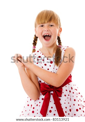 Happy laughing seven years girl portrait isolated - stock photo