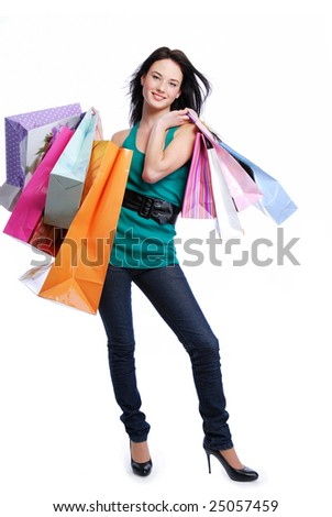 Happy laughing young woman with color bags - white background