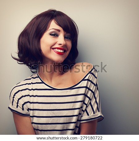 Happy laughing young woman with short hair in fashion blouse. Vintage closeup portrait