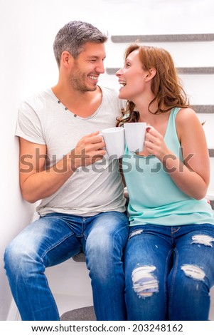 happy laughing younger parent couple - stock photo