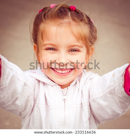 happy liitle girl make selfie close-up - stock photo