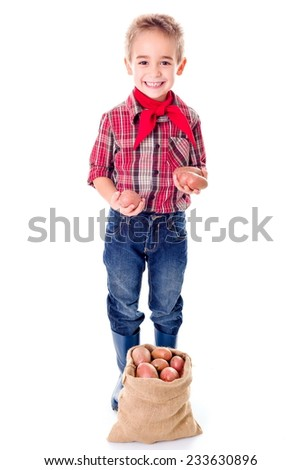 Happy little agriculturist boy showing good potato harvest - stock photo