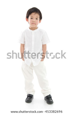 Happy little asian boy in white clothes on white background isolated