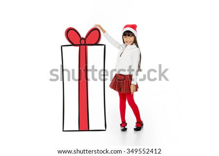 happy little asian girl showing her gift to someone - stock photo