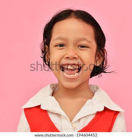 Happy little asian girl smiling. - stock photo