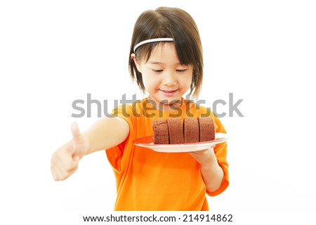 Happy little Asian girl with sweet - stock photo